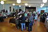 Citizens file into the Houghton Mansion and look at the many goods during the Holiday Gift Extravaganza Bazaar Saturday. The bazaar benefited the Northern Berkshire Santa Fund. (Jack Guerino/North Adams Transcript)