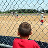 JULIE CROTHERS BEER | THE GOSHEN NEWS<br /> Ean Bogan of Nappanee watches as children participate in the Home Run Derby Tuesday afternoon at Stauffer Park in Nappanee.