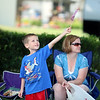 JULIE CROTHERS BEER | THE GOSHEN NEWS<br /> Sid Leroux, 5, waves a flag as he waits with his mom Tammy Leroux of Nappanee for the start of the Nappanee Independence Day parade Tuesday.