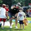 JULIE CROTHERS BEER | THE GOSHEN NEWS John King of Nappanee shows Chance King, 3, the start of the Nappanee Independence Day parade Tuesday.