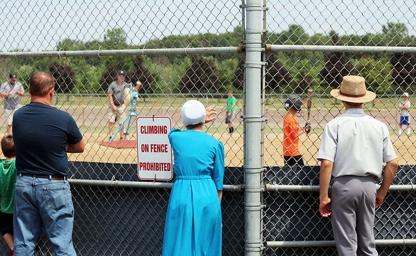 JULIE CROTHERS BEER   THE GOSHEN NEWS<br /> Spectators watch as children participate in the Home Run Derby event Tuesday in Nappanee. The event was part of the city's annual Independence Day celebration at Stauffer Park.