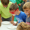 ADAM RANDALL | THE GOSHEN NEWS<br /> Various age groups competed to see who could blow a bubble the fastest. But first, they had to find the chewing gum hidden in a plate of whipped cream.