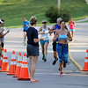 ADAM RANDALL | THE GOSHEN NEWS<br /> Runners entire the finish line at the 39th Annual Flotilla Road Race in Syracuse Tuesday.