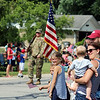 JULIE CROTHERS BEER | THE GOSHEN NEWS<br /> The Hertsel family watches as the Nappanee Independence Day parade begins Tuesday. From left are George, 6, Lizzy, 8, Caroline, 3, and Nick, 1, with mom Sarah and dad Mike, all of Nappanee.