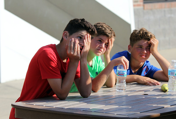 ADAM RANDALL   THE GOSHEN NEWS<br /> From left: Cohen Custer, 12, Brooks Custer, 10, and Austin Custer, 13, all of Syracuse, take a break during the Flotilla Road Race Tuesday.
