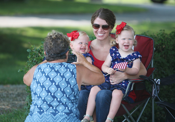 JULIE CROTHERS BEER | THE GOSHEN NEWS<br /> Grandma Susan Sheets of Nappanee takes a photo of Katie Sheets and her 2-year-old twin daughters Nyla and Sayda Sheets as the group awaits the start of the Nappanee Independence Day parade.