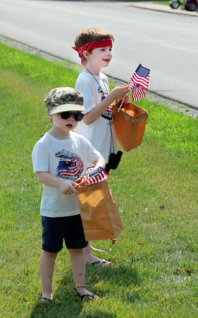 JULIE CROTHERS BEER | THE GOSHEN NEWS<br /> Chance King, 3, and Phoenix King, 7, wait excitedly for the Nappanee parade to begin on Tuesday.