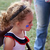 ADAM RANDALL | THE GOSHEN NEWS<br /> Ninna Neely, 3, Topeka, gets had an American flag painted on her face during Topeka's Fourth of July festivities Tuesday.