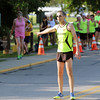 ADAM RANDALL | THE GOSHEN NEWS<br /> Brian Shepherd directs runners at the Flotilla Road Race Tuesday in Syracuse.