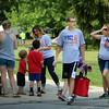 JULIE CROTHERS BEER | THE GOSHEN NEWS<br /> Parade participants hand out American flags during the event Tuesday in Nappanee.