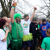 JULIE CROTHERS BEER | THE GOSHEN NEWS<br /> Participants cheer before jumping into Simonton Lake during the 12th annual Leprechaun Leap Saturday, March 18. The annual event benefits United Cancer Services of Elkhart County.