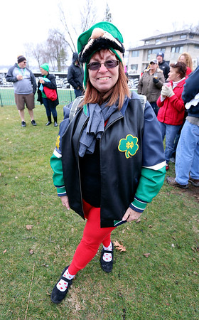 JULIE CROTHERS BEER | THE GOSHEN NEWS<br /> Veronica DeMoss, of Mishawaka, poses for a photo during the 12th annual Leprechaun Leap at Simonton Lake in Elkhart Saturday, March 18. The annual event benefits United Cancer Services of Elkhart County.