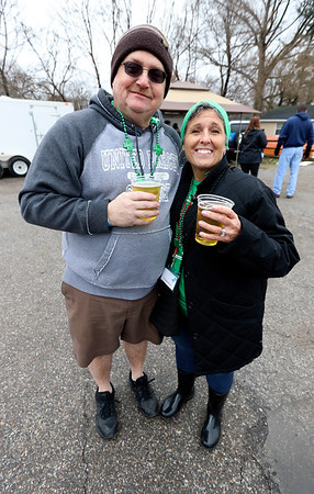 JULIE CROTHERS BEER | THE GOSHEN NEWS<br /> Jason Cronk, of South Bend, and Sharon Maddux, of Elkhart, pose for a photo during the 12th annual Leprechaun Leap at Simonton Lake in Elkhart Saturday, March 18. The annual event benefits United Cancer Services of Elkhart County.