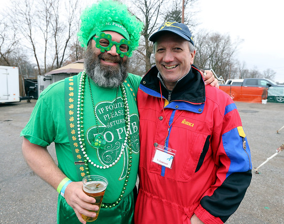 JULIE CROTHERS BEER | THE GOSHEN NEWS<br /> Larry Ward and Joe Kilgren, both of Elkhart, pose for a photo during the 12th annual Leprechaun Leap at Simonton Lake in Elkhart Saturday, March 18. The annual event benefits United Cancer Services of Elkhart County.