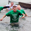 JULIE CROTHERS BEER | THE GOSHEN NEWS<br /> Dustin Blevins, of Elkhart, heads for the shore after jumping into Simonton Lake during the 12th annual Leprechaun Leap Saturday, March 18. The annual event benefits United Cancer Services of Elkhart County.