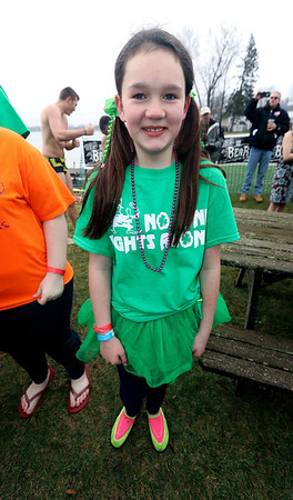 JULIE CROTHERS BEER | THE GOSHEN NEWS<br /> Kylinne Jones, of Syracuse, poses for a photo during the 12th annual Leprechaun Leap at Simonton Lake in Elkhart Saturday, March 18. The annual event benefits United Cancer Services of Elkhart County.