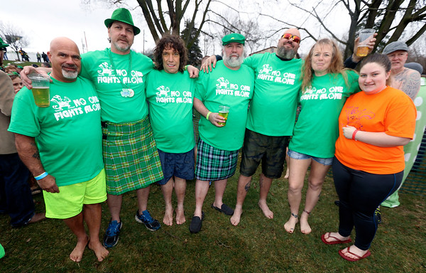 JULIE CROTHERS BEER | THE GOSHEN NEWS<br /> Participants pose for a photo during the 12th annual Leprechaun Leap at Simonton Lake in Elkhart Saturday, March 18. The annual event benefits United Cancer Services of Elkhart County. From left, Tracey Moore, of Middlebury, Tom Archer, of Syracuse, Charlie Renard, of Elkhart, Al Teegarden, of Sturgis, Michigan, George Musialik, of South Bend, Teresa Morgan, of South Bend, and Cayla Renard, of Elkhart.
