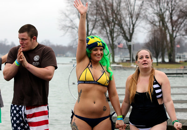 JULIE CROTHERS BEER | THE GOSHEN NEWS<br /> Participants wave before jumping into Simonton Lake during the 12th annual Leprechaun Leap Saturday, March 18. The annual event benefits United Cancer Services of Elkhart County.