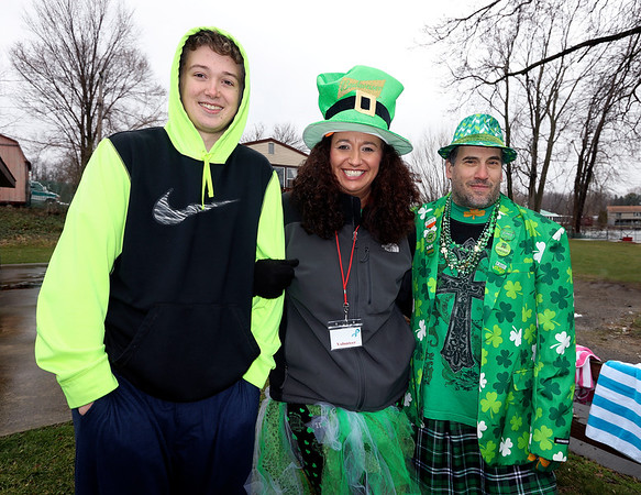 JULIE CROTHERS BEER | THE GOSHEN NEWS<br /> Cody Spencer and Michelle Pfeil, of Bristol, and Jake Smoot, of Elkhart, pose for a photo during the 12th annual Leprechaun Leap at Simonton Lake in Elkhart Saturday, March 18. The annual event benefits United Cancer Services of Elkhart County.