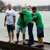 JULIE CROTHERS BEER | THE GOSHEN NEWS<br /> Participants share a hug before jumping into Simonton Lake during the 12th annual Leprechaun Leap Saturday, March 18. The annual event benefits United Cancer Services of Elkhart County.