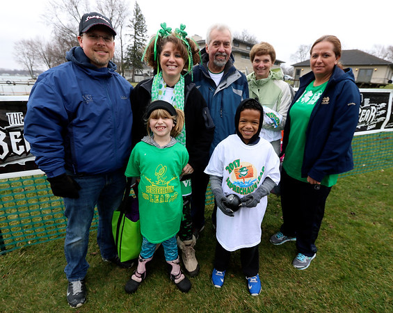 JULIE CROTHERS BEER | THE GOSHEN NEWS<br /> Participants pose for a photo during the 12th annual Leprechaun Leap at Simonton Lake in Elkhart Saturday, March 18. The annual event benefits United Cancer Services of Elkhart County. Back row from left, Eric and Carissa Williams, of Goshen, Gary and Nona Packer, of Warsaw, and Jami Packer, of Elkhart. Front row, Mia Williams, 7, of Goshen, and Portlin Taylor, 7, of Elkhart.