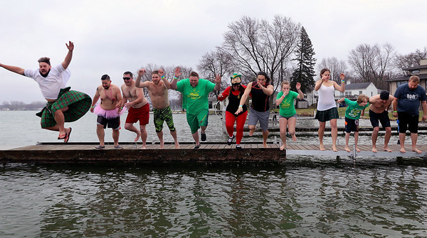 JULIE CROTHERS BEER | THE GOSHEN NEWS<br /> Participants jump into Simonton Lake during the 12th annual Leprechaun Leap Saturday, March 18. The annual event benefits United Cancer Services of Elkhart County.