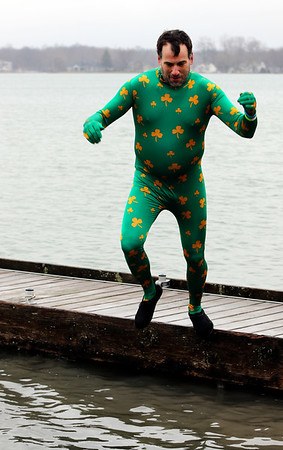 JULIE CROTHERS BEER | THE GOSHEN NEWS<br /> Jacob Smoot, of Elkhart, jumps into the lake during the 12th annual Leprechaun Leap at Simonton Lake in Elkhart Saturday, March 18. The annual event benefits United Cancer Services of Elkhart County.