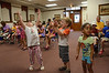 From left, Danielle King, 4, Jeremy Zepka, 4, and Aviana Saimbert, 3, dance to music at the Adams Free Library on Tuesday July 30, 2013 during a performance by Tom Sieling of Newfield, NY entitled 'Howl at the Moon.' The musical presentation was sponsored by the library's summer reading program which is themed, 'Dig into Reading.' (Gillian Jones/North Adams Transcript)