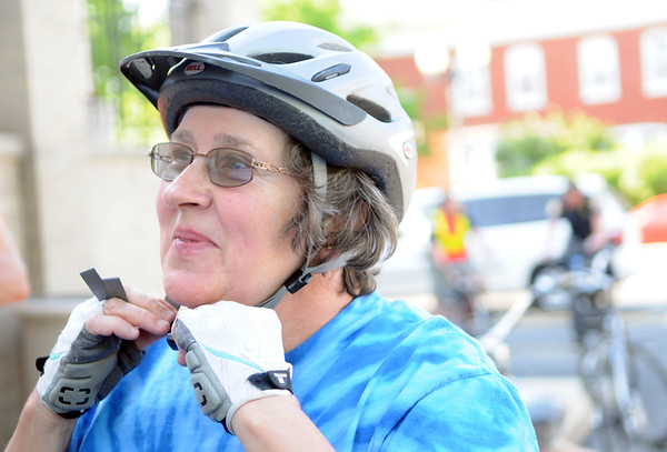 HALEY WARD | THE GOSHEN NEWS<br /> Laurie Tweddale straps on her helmet before the Mayors Ride on Monday outside City Hall. The ride was 4.5 miles and ended at The Chief.