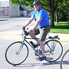 HALEY WARD | GOSHEN NEWS<br /> Former-mayor Allan Kauffman rides in the Mayors Ride on Monday outside City Hall. Mayor Jeremy Stutsman removed the apostrophe off the orginal title to include the former mayors, who helped make Goshen a biking community.