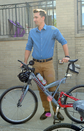 HALEY WARD | THE GOSHEN NEWS<br /> Mayor Jeremy Stutsman speaks before the Mayors Ride on Monday outside City Hall. Mayor Stutsman plans on riding his bike to work the rest of this week for Goshen's Bicycle-to-Work week.