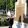 SHEILA SELMAN | THE GOSHEN NEWS<br /> John Alheim, right, helps place a wreath at the Elkhart County War Memorial Monday morning.
