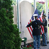 SHEILA SELMAN | THE GOSHEN NEWS<br /> Goshen Honor Guard members Jeff Schrock and Randy Kantner raise the flag at the Elkhart County War Memorial in Goshen Monday morning.