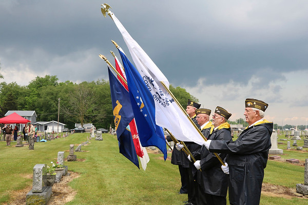 SHERRY VAN ARSDALL | THE GOSHEN NEWS<br /> Members of Goshen Veterans Honor Guard stand at attention during the Memorial Day services in New Paris Cemetery in New Paris Sunday. A brief thunderstorm delayed the services by 15 minutes.