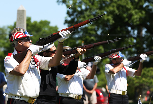 JAY YOUNG | THE GOSHEN NEWS<br /> Members of the American Legion Mark L. Wilt Post 210 color guard and firing squad fire a three-volley salute during a Memorial Day ceremony at Grace Lawn Cemetery Monday morning in Middlebury.