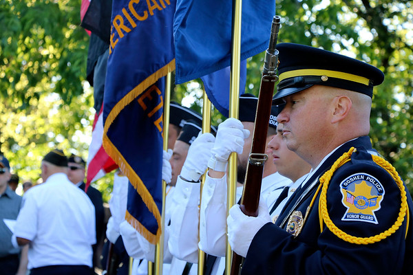 SHEILA SELMAN | THE GOSHEN NEWS<br /> Goshen Honor Guard member Shayne Miller stands ready at the Memorial Day service at Rogers Park footbridge Monday morning.