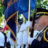 SHEILA SELMAN | THE GOSHEN NEWS<br /> Goshen Honor Guard member Shayne Miller stands ready at the Memorial Day service at Rogers Park footbridge Monday morning.