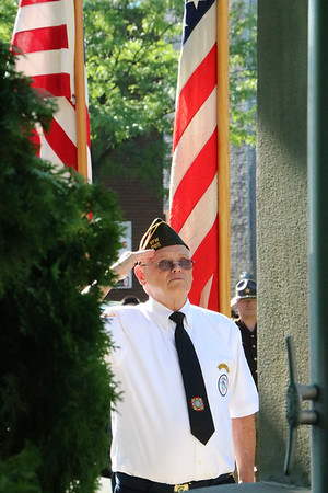 SHEILA SELMAN | THE GOSHEN NEWS<br /> John Alheim salutes the flag as it as raised at the Elkhart County War Memorial in front of the Elkhart County Courthouse Monday morning.