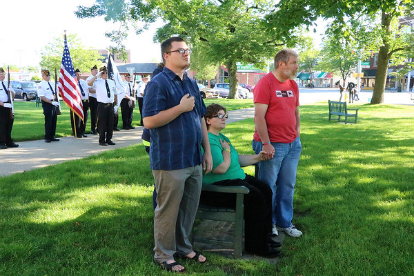 SHEILA SELMAN | THE GOSHEN NEWS<br /> A family pays their respects at Monday morning's Memorial Day service at the Elkhart County War Memorial. From left are Chris Sherlock, Goshen, Ella Sherlock, Nappanee (hidden), Rachael Prescott and Mark Prescott, both of Goshen.