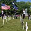 JAY YOUNG | THE GOSHEN NEWS<br /> Members of the American Legion Mark L. Wilt Post 210 color guard and firing squad march through Grace Lawn Cemetery during a Memorial Day ceremony Monday morning in Middlebury.