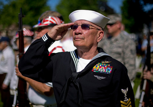 JAY YOUNG | THE GOSHEN NEWS<br /> Retired Navy veteran Ken Jones and member of the American Legion Mark L. Wilt Post 210 in Middlebury, salutes the flag as the Star Spangled Banner is played by the Northridge High School Band during a Memorial Day ceremony at Memorial Park in downtown Middlebury Monday morning.