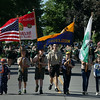 JAY YOUNG | THE GOSHEN NEWS<br /> Members of Middlebury Boy Scouts Troop 7, Cub Scouts Pack 770 and Girl Scouts Troop 377 carry flags as they march down Main Street during a Memorial Day parade in Middlebury Monday morning.