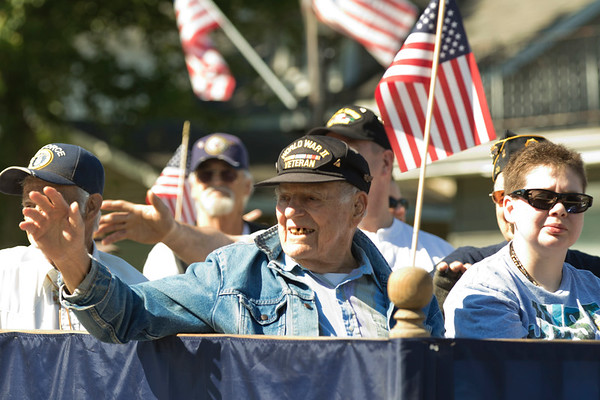 JAY YOUNG | THE GOSHEN NEWS<br /> World War II veteran Dick Sutz waves to the crowd as he rides down Main Street during a Memorial Day parade in downtown Middlebury Monday morning.