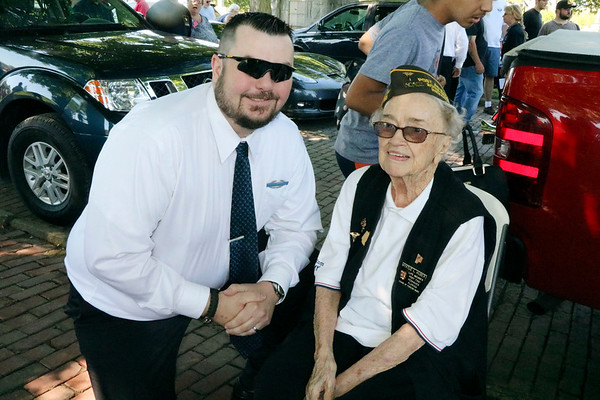 SHEILA SELMAN | THE GOSHEN NEWS<br /> Memorial Day guest speaker, Kenneth Holmes, an Army veteran who served in Iraq, chats with parade marshal Myrtle Huber, an Army nurse who served in World War II in the Philippines.