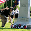 SHEILA SELMAN | THE GOSHEN NEWS<br /> Elkhart County Sheriff Brad Rogers lays a wreath at the veterans monument at Oakridge Park in Goshen Monday.