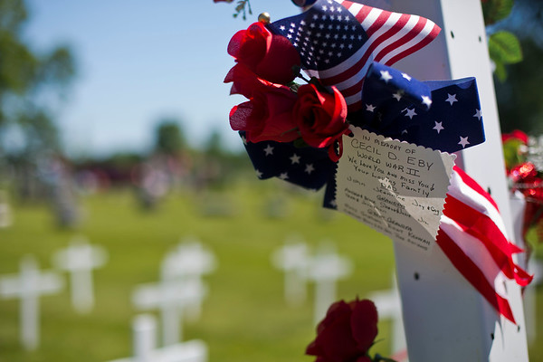 JAY YOUNG | THE GOSHEN NEWS<br /> A handwritten note honoring the memory of World War II veteran Cecil D. Eby hands from a memorial in Grace Lawn Cemetery.