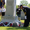 SHEILA SELMAN | THE GOSHEN NEWS<br /> Goshen Fire Chief Dan Sink lays a wreath at the monument dedicated to veterans at Oakridge Cemetery in Goshen Monday.