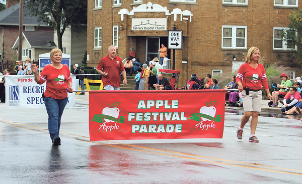 JULIE CROTHERS BEER | THE GOSHEN NEWS<br /> Rainy weather didn't stop visitors from attending the annual Nappanee Apple Festival parade Saturday morning. The parade lasted approximately one hour and included service groups, police and fire departments, churches and more.
