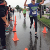 JULIE CROTHERS BEER | THE GOSHEN NEWS<br /> Kathy Snelling of Mishawaka throws her hands in the air after crossing the finish line during the Nappanee Apple Festival 5K Road Run/Walk.