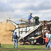 JULIE CROTHERS BEER | THE GOSHEN NEWS<br /> Nappanee Apple Festival attendees gather around for a hay baling demonstration Saturday at the Antique Tractor and Engine Show.